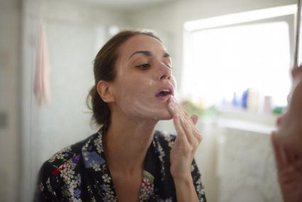 How hard to scrub your face while cleansing, according to a dermatologist