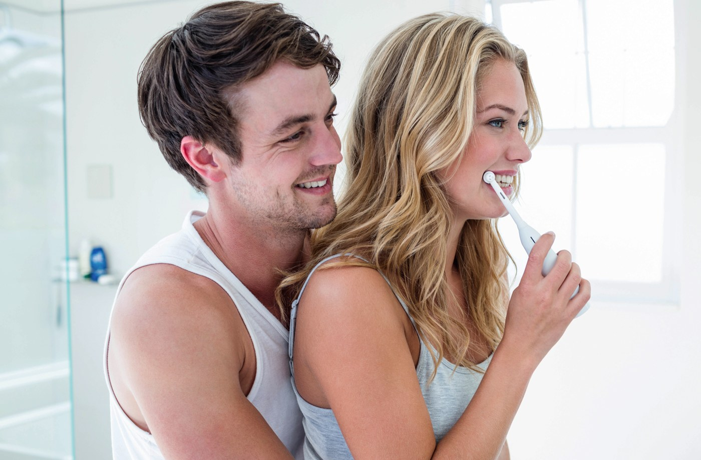 Here's how gross sharing a toothbrush with your partner really is, according to a dentist