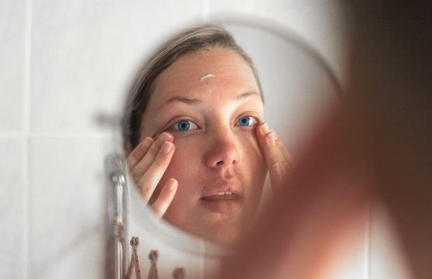 The derm-approved guide to getting rid of those pesky white dots underneath your eyes