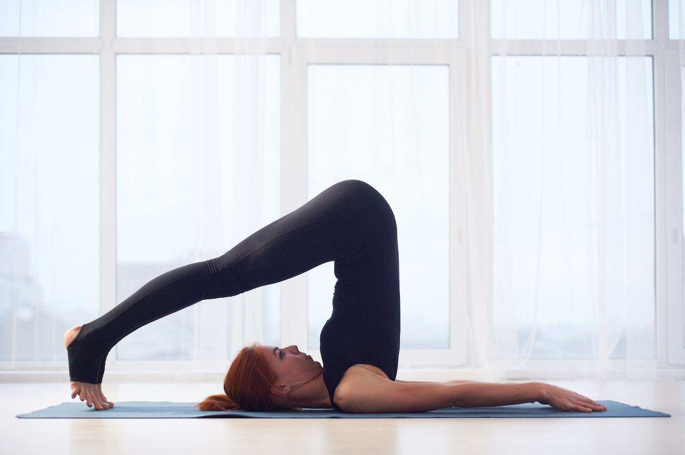 If you've had a dizzy spell during yoga, here's what could be behind it