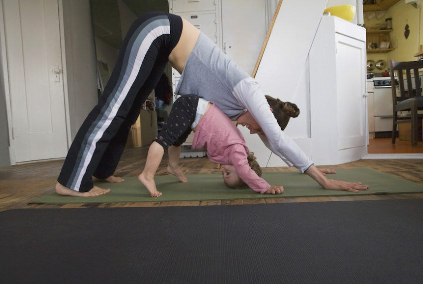 Are toddlers doing downward dog pregnancy-predicting witches? Here's a body-language expert's take