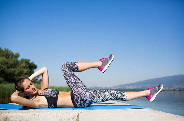 Bicycle kicks are the most underrated way to blast your abs—but are you doing them right?