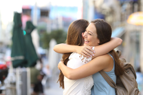 Hugger, high-fiver, or cheek-kisser? Your greeting style says a lot about your personality
