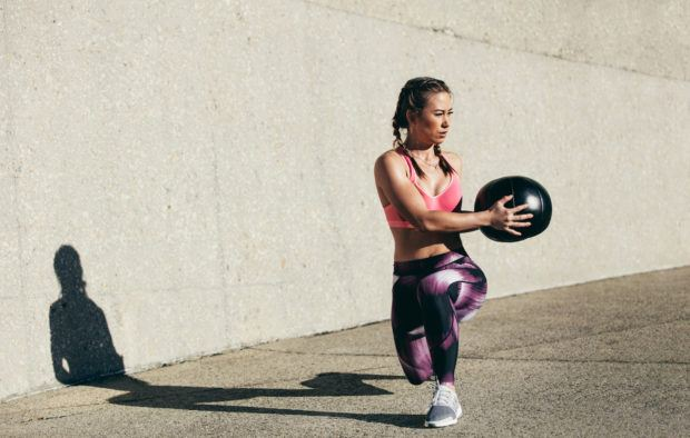 This 10-move medicine ball workout proves one tool can torch your total body