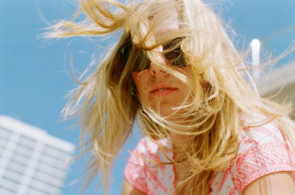 This just in: Your favorite summer skin savior is the key to treating dry hair, too