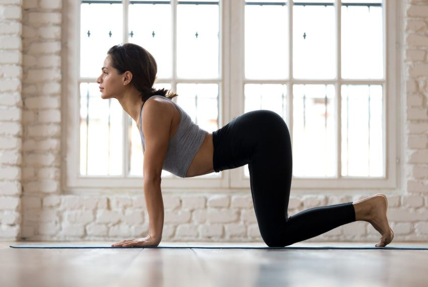 5 Trainer-Approved Stretches That (Quickly) Help to Ease That Holiday Weekend Bloat