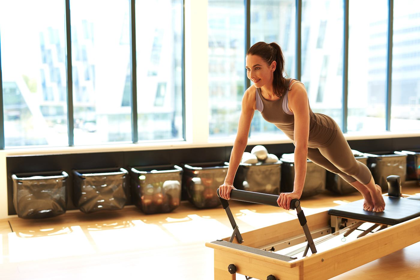 Thumbnail for A *Lot* of People Are Ditching Bootcamps for Pilates—and There's a Science to Why