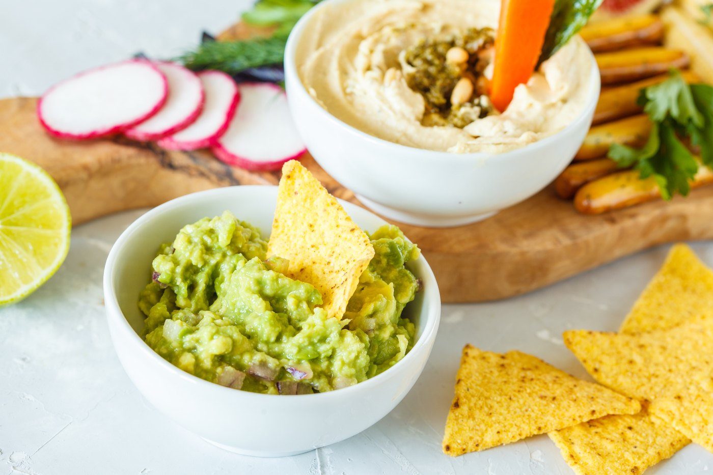 Thumbnail for In a battle between hummus and guac, which healthy snack dip wins?