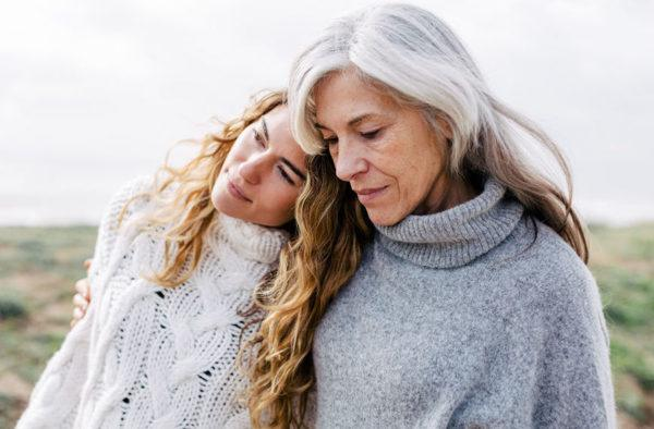 perimenopausal depression two women taking a walk in winter with sweaters
