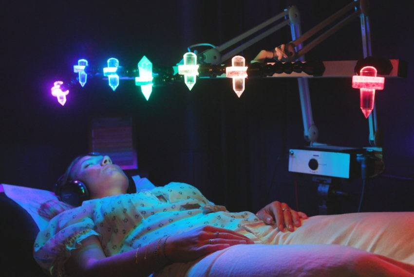 Heal your chakras in the most colorful way using rainbow crystal light therapy