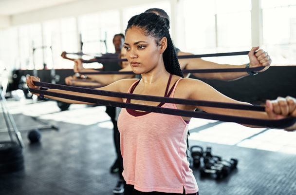 This 4-minute resistance band workout tones your whole body—no shower required