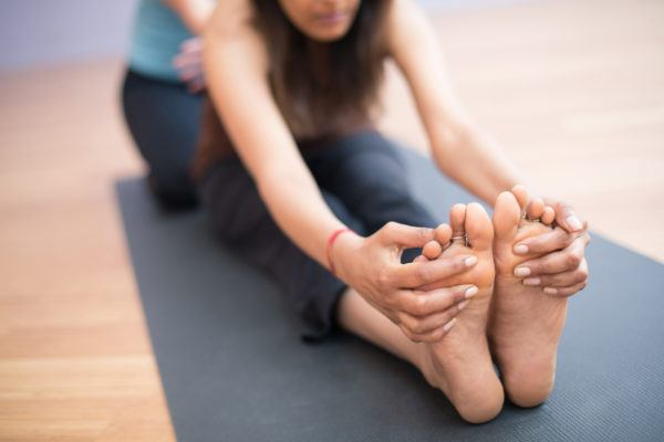 These 10 yoga stretches will help your aching feet