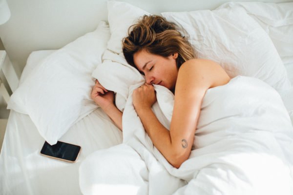 How to decompress your spine while you sleep, according to a professional stretcher