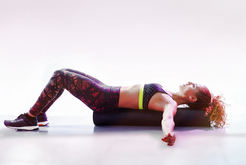 How to decompress your spine using a foam roller, according to a Pilates...