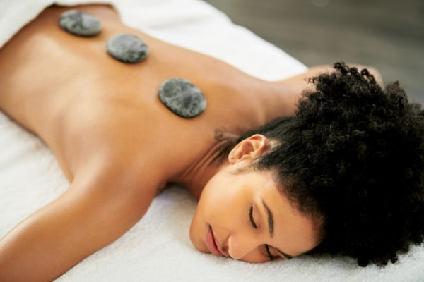 Turn up the heat on your self care with a hot stone massage