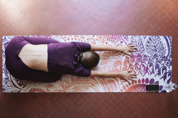 I'm a yoga therapist and MD, and these are the 5 middle back stretches I recommend every day for a healthy spine