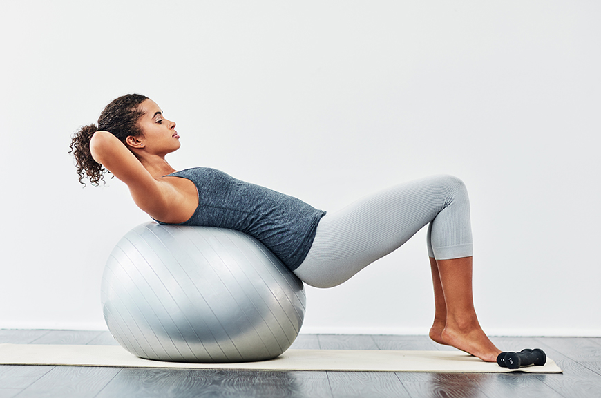 Thumbnail for 5 Moves That Prove an Exercise Ball Is the Underrated Way to Stretch Your Lower Back