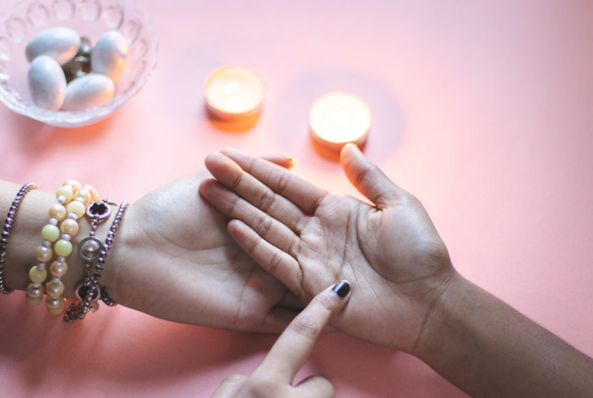 How to read your astrological chart using just your hand, according to a palm reader