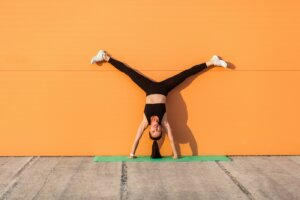 The 'handstand challenge' is actually a great workout—here's how to modify it