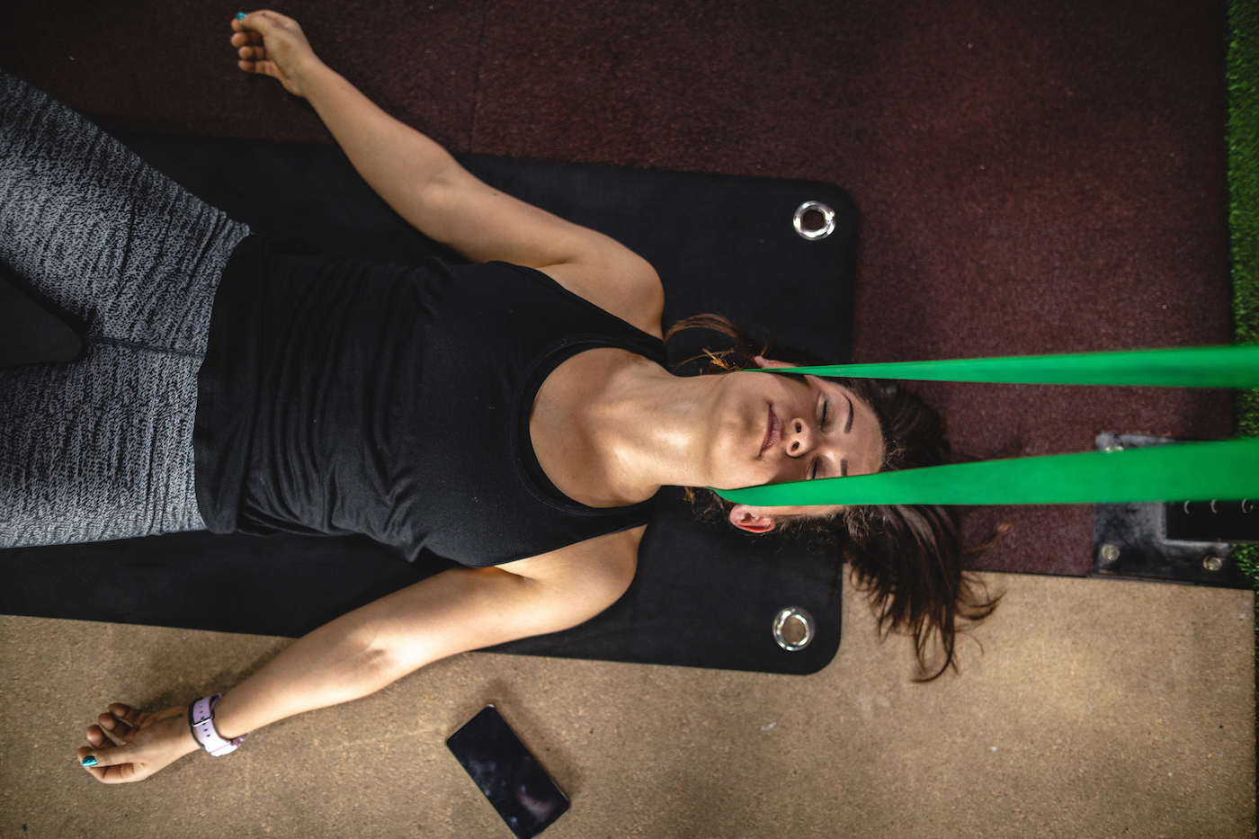 Thumbnail for All you need is a towel and a resistance band for this 5-minute neck decompression stretch