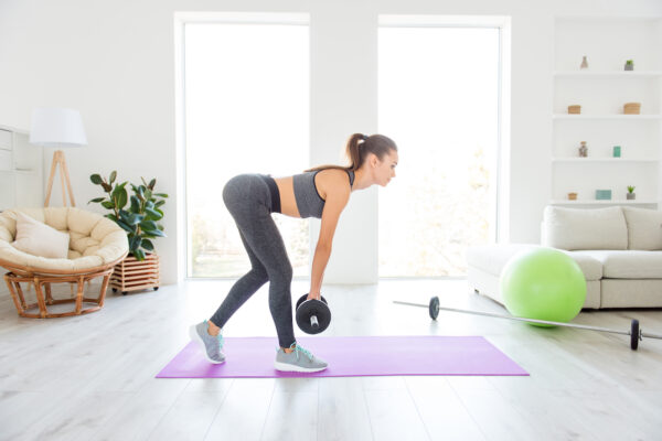 How to Lift Weights at Home Whether You're a Fitness Newb or a Strength-Training Pro