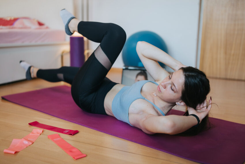 Think full-body Pilates is hard? Try adding a resistance band with this 30-minute workout