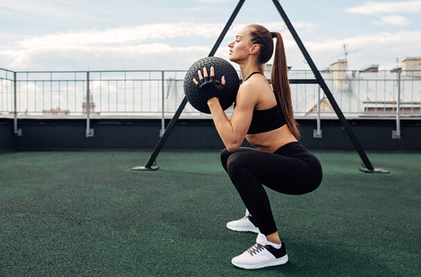 3 Trainer-Approved Ways to Practice Sitting Back Deeper Into Your Squats