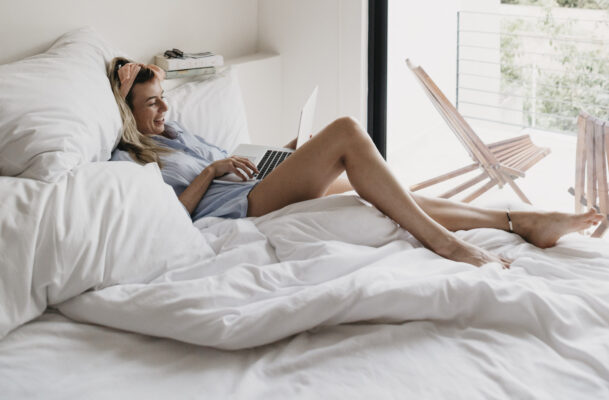 If You Absolutely Must Work From Your Bed, Posture Pros Say This Is a Must-Read