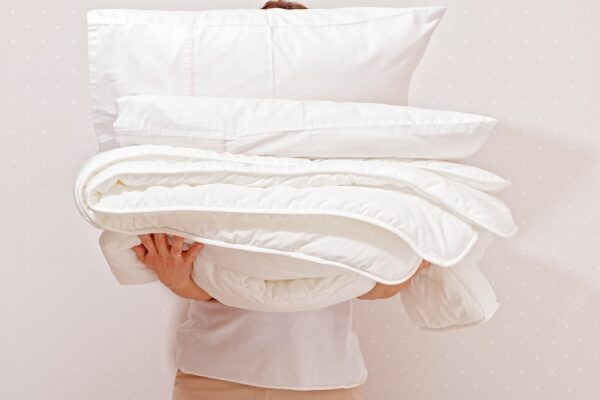 How To Wash Your Comforter Properly—Because You're Not Doing It Often Enough, and You Know It