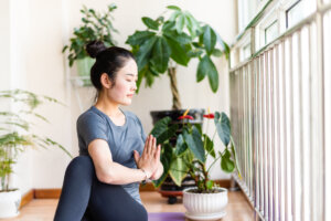 Take 3 Minutes To Wring Out Your Spine With This Yoga Pose