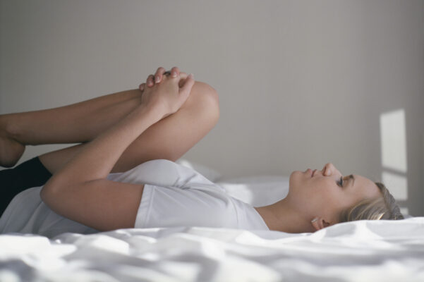 3 Stretches for When Menstrual Cramps Leave Your Uterus in Knots
