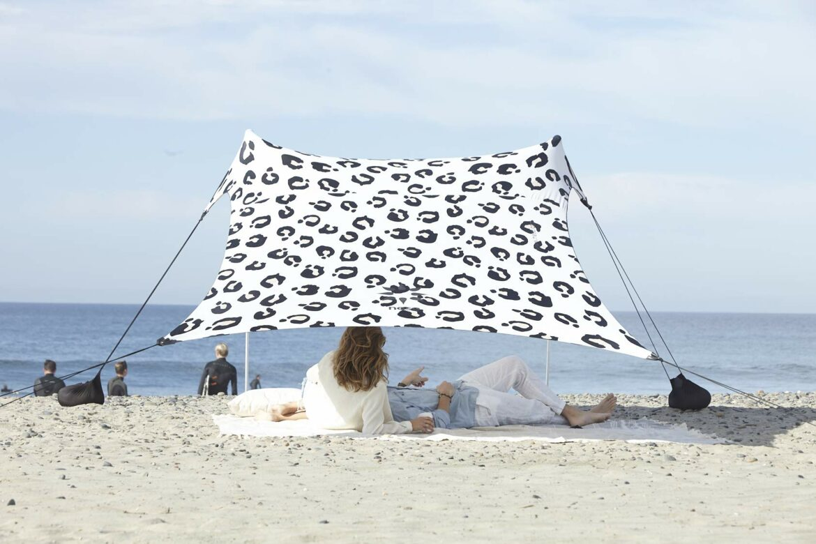 Thumbnail for Forget Umbrellas, the Neso Sun Shade Is a Better Way To Stay Cool and Protected on the Beach