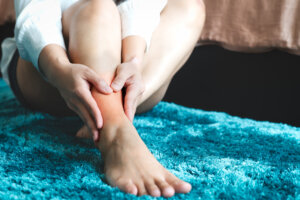 The Easiest Way To Relieve Foot and Toe Pain While Lounging on the Couch, According to a Podiatrist